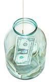 Sopra la vista della banconota di cattura dei dollari dal barattolo Fotografia Stock
