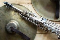 Soprano saxophone. Old soprano saxophone on wooden background Stock Image