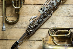 Soprano saxophone. Old soprano saxophone on wooden background Royalty Free Stock Photography