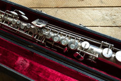 Soprano saxophone. Old soprano saxophone on wooden background stock photo