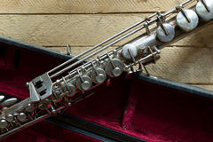 Soprano saxophone. Old soprano saxophone on wooden background stock images