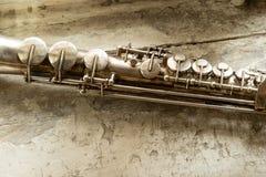 Soprano saxophone. Old soprano saxophone on wooden background Royalty Free Stock Image