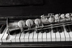 Soprano saxophone. On piano keys stock photo