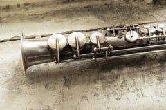 Soprano saxophone. On wooden background stock image