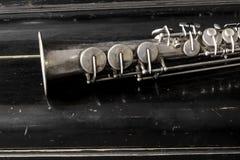 Soprano saxophone. On wooden background stock photos
