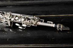 Soprano saxophone. On wooden background Royalty Free Stock Photography