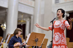 Soprano Yui Don Ni. St. Petersburg, Russia - October 6, 2015: Soprano Yui Don Ni from Star Sopranos of China on the rehearsal with the Andreyev State Russian royalty free stock photos