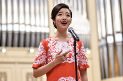Soprano Yui Don Ni. St. Petersburg, Russia - October 6, 2015: Soprano Yui Don Ni from Star Sopranos of China on the rehearsal with the Andreyev State Russian royalty free stock image