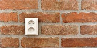 Soquete em uma parede de tijolo Imagem de Stock