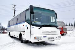 SOR LC10.5 Arktika. PANGODY, RUSSIA - FEBRUARY 4, 2013: White SOR LC10.5 Arktika interurban coach at the city street Royalty Free Stock Photography