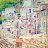 Sorano. Bird's Eye View on the Roofs of the City of Sorano in Italy, Retro Effect Stock Photo