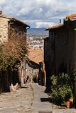 Sorano, Grosseto, Tuscany, Italy: alley in the old town. And Tyrrhenian Sea Royalty Free Stock Photo