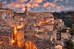 Sorano, Grosseto, Tuscany, Italy: landscape at dawn. Of the picturesque medieval village on the Tuscan hills Stock Images