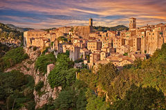 Sorano, Grosseto, Tuscany, Italy. Landscape at the sunset of the picturesque medieval village on the hill Stock Images