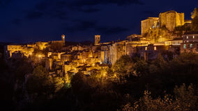 Sorano, Grosseto, Tuscany, Italy. Night landscape of the picturesque medieval village on the hill Stock Image
