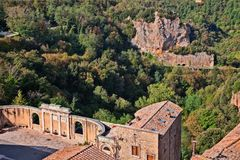 Landscape from Sorano, Grosseto, Tuscany, Italy. Sorano, Grosseto, Tuscany, Italy: the square of the source and aqueduct with view of the forest and the rock Royalty Free Stock Photography