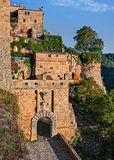 Sorano, Grosseto, Tuscany, Italy: view of the city gate Porta de. Sorano, Grosseto, Tuscany, Italy: landscape from the medieval village with the ancient city Royalty Free Stock Photo