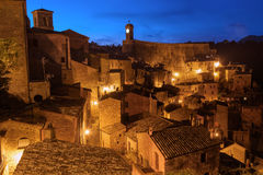 Sorano at night. Sorano - tuff city in Tuscany. Italy. View in the dusk with illumination, travel background Royalty Free Stock Images