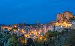 Sorano at night. Sorano - tuff city in Tuscany. Italy. View in the dusk with illumination, travel background Stock Photo