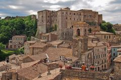 Sorano, small town in Tuscany with fortress. Hidden in the green, there are stone medieval houses of town Sorano in Tuscany royalty free stock photo