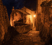 Sorano street at night. Street of ancient medieval tuff city Sorano at night  - travel european background Stock Photography