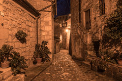 Sorano street at night. Street of ancient medieval tuff city Sorano at night  - travel european background Royalty Free Stock Images