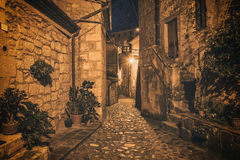 Sorano street at night. Street of ancient medieval tuff city Sorano at night  - travel european background Royalty Free Stock Image