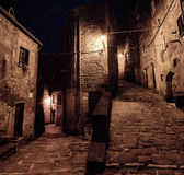 Sorano street at night. Street of ancient medieval tuff city Sorano at night  - travel european background Royalty Free Stock Photography