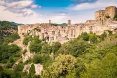 Sorano, a town built on a tuff rock, is one of the most beautifu. Panorama of Sorano, a town built on a tuff rock, one of the most beautiful villages in Italy stock photography