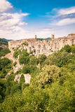 Sorano, a town built on a tuff rock, is one of the most beautifu. Panorama of Sorano, a town built on a tuff rock, one of the most beautiful villages in Italy Royalty Free Stock Images