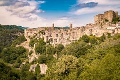 Sorano, a town built on a tuff rock, is one of the most beautifu. Panorama of Sorano, a town built on a tuff rock, one of the most beautiful villages in Italy Royalty Free Stock Photography