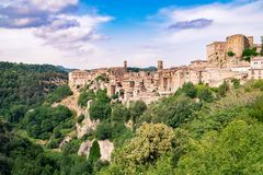 Sorano, a town built on a tuff rock. Panorama of Sorano, a town built on a tuff rock, one of the most beautiful villages in Italy Royalty Free Stock Photos