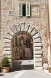 Sorano (Tuscany, Italy). Sorano (Grosseto, Tuscany, Italy), entrance through arch Royalty Free Stock Photos