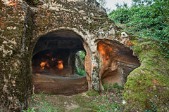 Sorano, Tuscany, Italy: ancient cave carved into the rock. Sorano, Grosseto, Tuscany, Italy: old cave carved into the tufa rock and used as human habitation in Stock Photo