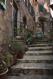 Sorano. View of the streets in the old  famous tuff city of Sorano. Old staircase with flowers in pots. Tuscany, Italy Stock Photo