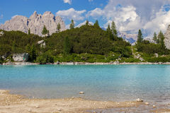 Sorapis lake in Dolomite Alps. Amazing view of Sorapis lake with unusual color of water. Lake located in Dolomite Alps, Italy Stock Photography
