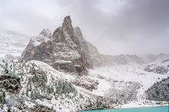 Sorapis lake in dolomiti, italy. The mountain lake Lago di Sorapiss in Dolomite Alps. Italy, with amazing turquoise color of water stock photo