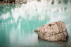 Sorapis lake in dolomiti mountains, italy. in winter. The mountain lake Lago di Sorapiss in Dolomite Alps. Italy, with amazing turquoise color of water stock photo