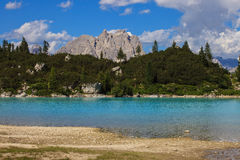 Sorapis lake in Italy. Amazing view of Sorapis lake with unusual color of water. Lake located in Dolomite mountains stock photo