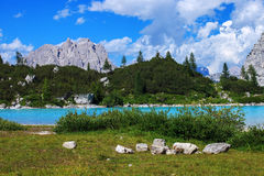 Sorapis lake in Italy. Amazing view of Sorapis lake with unusual color of water. Lake located in Dolomite mountains royalty free stock photography