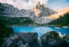 Sorapis lake Lago di Sorapis. Amazing view of Sorapis lake Lago di Sorapis at sunrise. Dolomites, Italy royalty free stock image