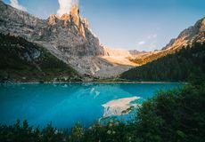 Sorapis lake Lago di Sorapis. Amazing view of Sorapis lake Lago di Sorapis at sunrise. Dolomites, Italy royalty free stock photo