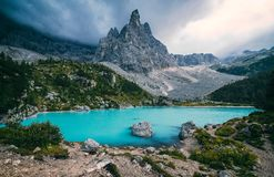 Sorapis lake Lago di Sorapis. Unusual turquoise Sorapis lake Lago di Sorapis at dusk. Dolomites, Italy stock image