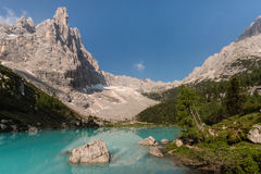 Sorapiss peak and lake in Dolomites Stock Photo