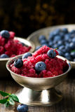 Sorbet from bilberry. In metal vases and fresh blueberry in a bowl. style vintage. selective focus Stock Photography