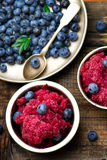 Sorbet from bilberry. In metal vases and fresh blueberry in a bowl. style vintage. selective focus Stock Photos