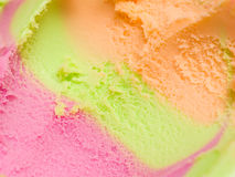 Sorbet dessert background. With orange, lime and raspberry Stock Photos