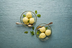 Sorbet ice cream. Fresh fruit sorbet ice cream in a glass plate - overhead shots Stock Photos