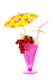 Sorbet ice cream. In pink with fruit and parasol Royalty Free Stock Photo