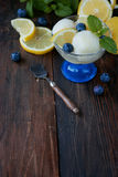Sorbet lemon with blueberry. Fresh sorbet lemon on a wooden table, top view, with free text space Royalty Free Stock Images